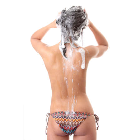 douche: Young woman in shower washing her hairs isolated on white background