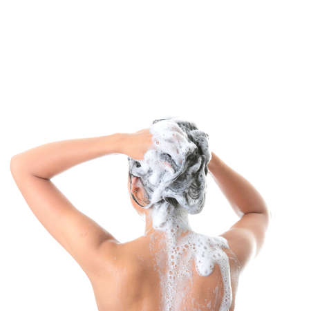 shampooing: Young woman in shower washing her hairs isolated on white background