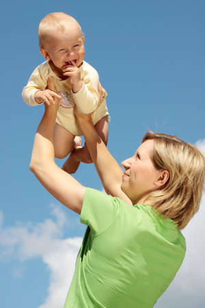 Mother with baby under blue clear sky Stock Photo - 5443739