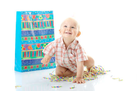Child boy in birthday hat over white Stock Photo - 5927788