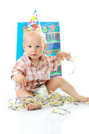 Child boy in birthday hat over white Stock Photo - 5927783