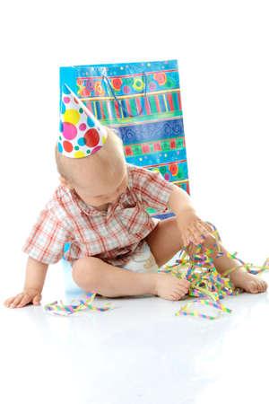 Child boy in birthday hat over white Stock Photo - 5362229