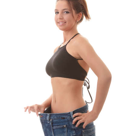 Woman showing how much weight she lost. Healthy lifestyles concept isolated on white background