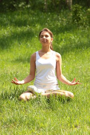 Beautiful young woman meditating outdoors Stock Photo - 5435065