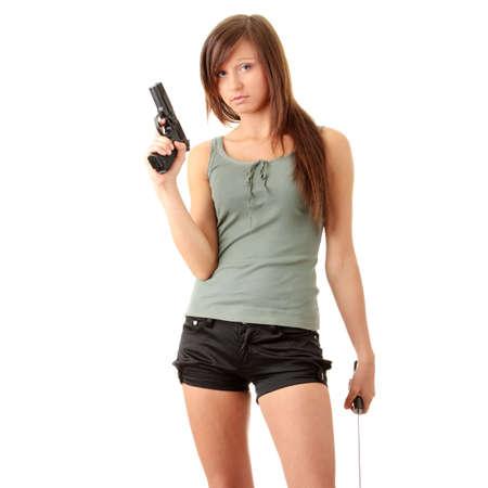 revolver:  Beautiful girl holding a black gun isolated Stock Photo