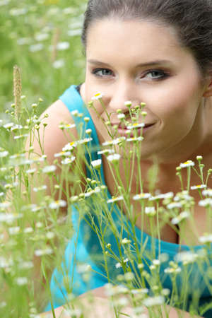 Beautiful young woman relaxing in the grass Stock Photo - 5364579