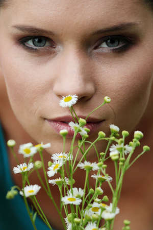 Beautiful young woman relaxing in the grass Stock Photo - 5364575