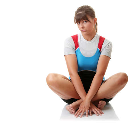 afloat: Young woman in rowing suit isolated Stock Photo