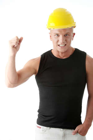 Young handsome angry builder in yellow helmet. Isolated over white background photo