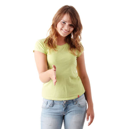Young casual woman with an open hand ready to seal a deal on a white background photo