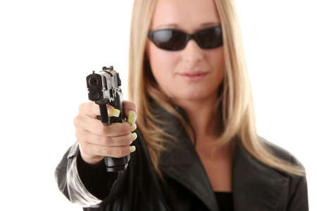 Portrait of the blonde with gun isolated on white background photo