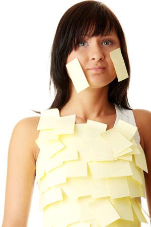 Young caucasian busines woman with yellow sticky note on her body photo