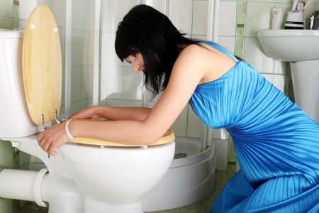 drunk woman: Young caucasian woman in toilet - pregnant,drunk or illness concept Stock Photo