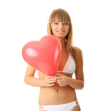 Happy young woman in bikini with heart shaped balloon - valentines concept Stock Photo - 5447468