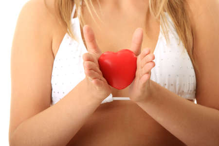 Young woman in bikini holding heart in her hands Stock Photo - 5447465