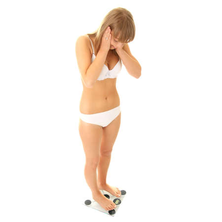 lose balance: Woman looking really happy about her weight loss, isolated on white.