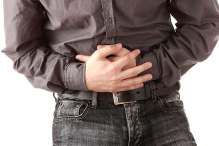 Man in black t-shirt having stomach ache  Islated on white