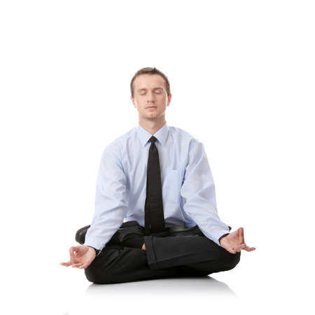 Businessman sitting in lotus position, Isolated against white background Stock Photo - 5435311