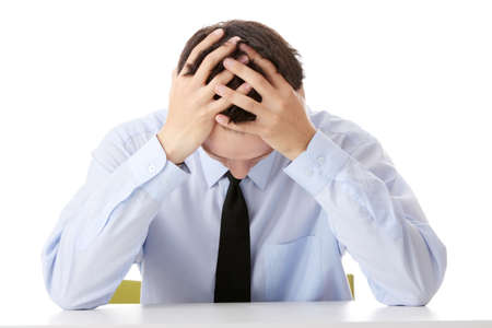 hand on forehead: Businessman in depression with hand on forehead, isolated over white