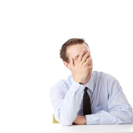 Businessman in depression with hand on forehead, isolated over white photo