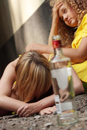 problematic: Teen alcohol addiction (drunk teens with vodka bottle)