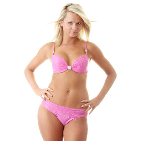 Young beautiful blond woman in pink swinsuit  Isolated on white Stock Photo - 24538363