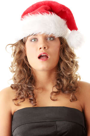Girl in Santas hat, isolated on white  photo