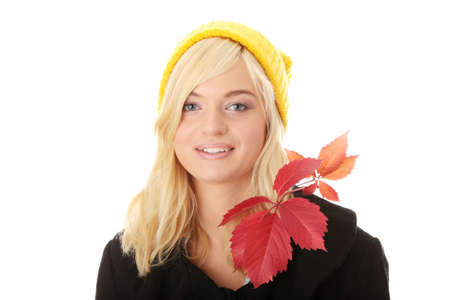 Autumn teen woman in yellow cap isolated photo