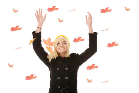Beautiful woman wearing yellow hat  playing with maple leaves  photo