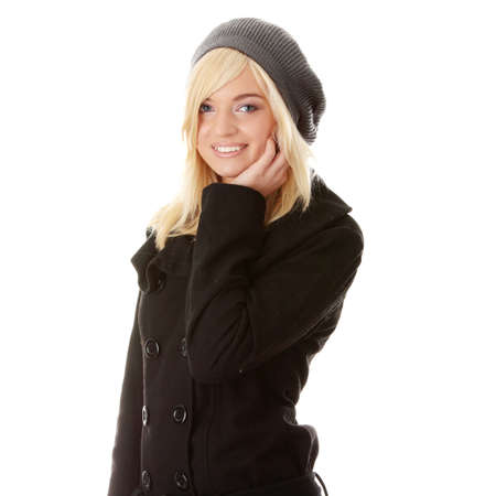Fashionable teen woman in autumn coat and grey hat photo