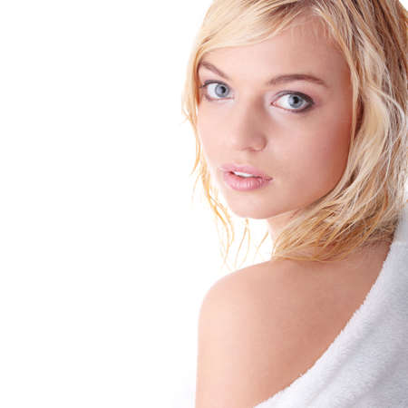 Young beautiful blond teen woman dressed in white bathrobe Stock Photo - 5930089