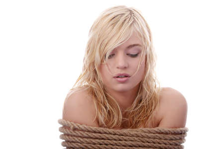 hostage: The beautiful blond girl tied with rope - kidnapping concept