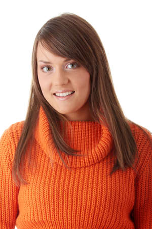 Teen woman in orange sweater isolated on white background  photo