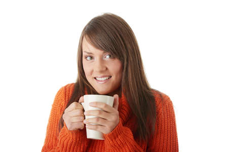 Portrait of teen woman in orange sweater with cup of coffee Stock Photo - 5930222