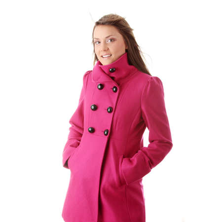 Teen woman in pink female coat isolated on white background photo