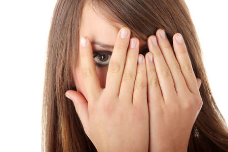 Frightened girl hiding her face behind her hands isolated on white background Stock Photo - 5929920