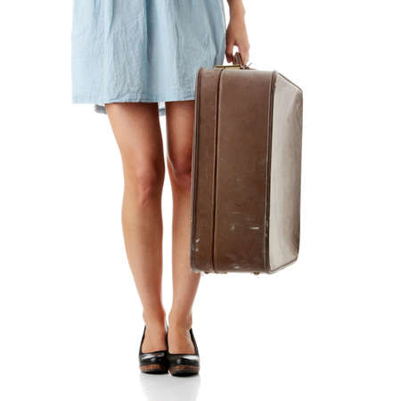 Caucasian woman legs with travel case isolated on white background  photo