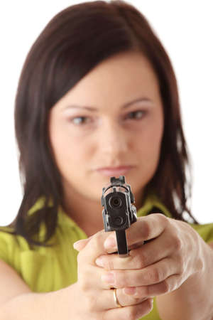 Angry woman with gun isolated on white photo