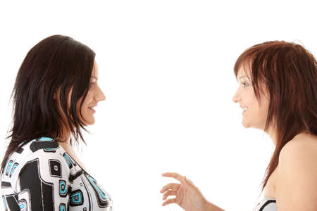 hesitations: Two young womans talking isolated on white background Stock Photo