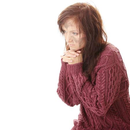 Poor dirty caucasian woman praying photo