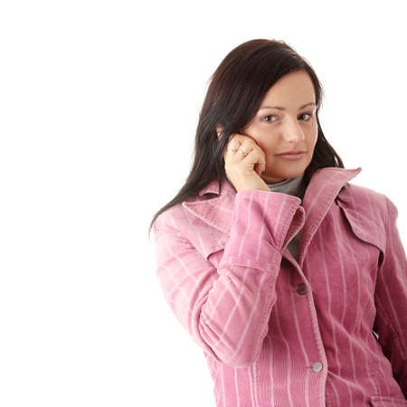 Young caucasian woman in winter pink coat talking by mobilephone, isolated photo