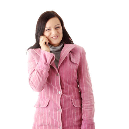 Young caucasian woman in winter pink coat talking by mobilephone, isolated Stock Photo - 5759131