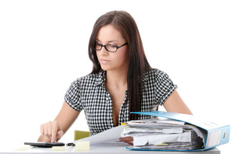refund: Female executive filling out tax forms while sitting at her desk. Isolated