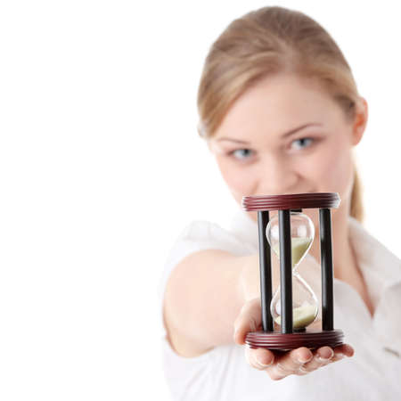Young business woman with hourglass - time concept photo