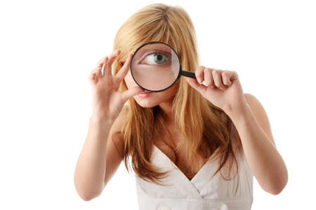 Young teenage girl with magnifier  searching and exploring concept  photo