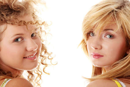 Two teen girlfriends isolated on white background Stock Photo - 5978358