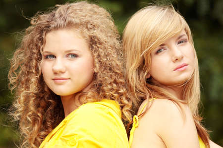 2 teen woman relaxing on sunny summer vacation day photo