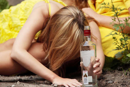 drunk: Teen alcohol addiction (drunk teens with vodka bottle)