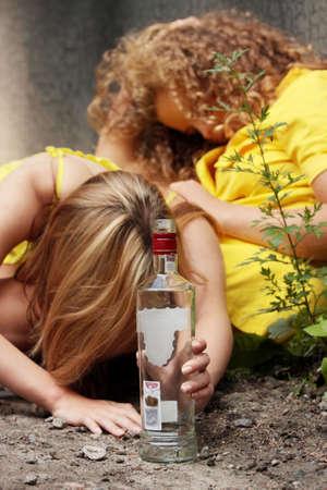 vandal: Teen alcohol addiction (drunk teens with vodka bottle)