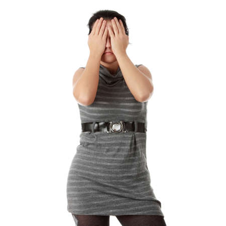 Young woman covering her eyes isolated photo